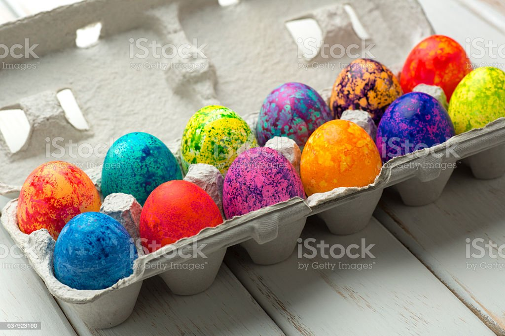 Beautiful Easter Eggs in  a Crate on White Wood stock photo
