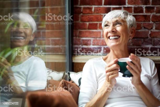 Beautiful elderly woman having a nostalgic moment while drinking a picture id1093224722?b=1&k=6&m=1093224722&s=612x612&h=kjure mcnzk3yh0lk4dg7lb ybdbt89jaltxwombn4m=