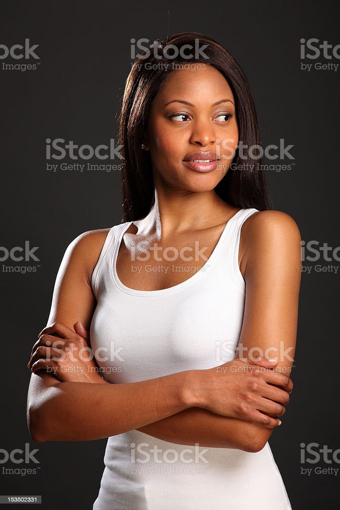 Beautiful elegant black woman in white vest stock photo
