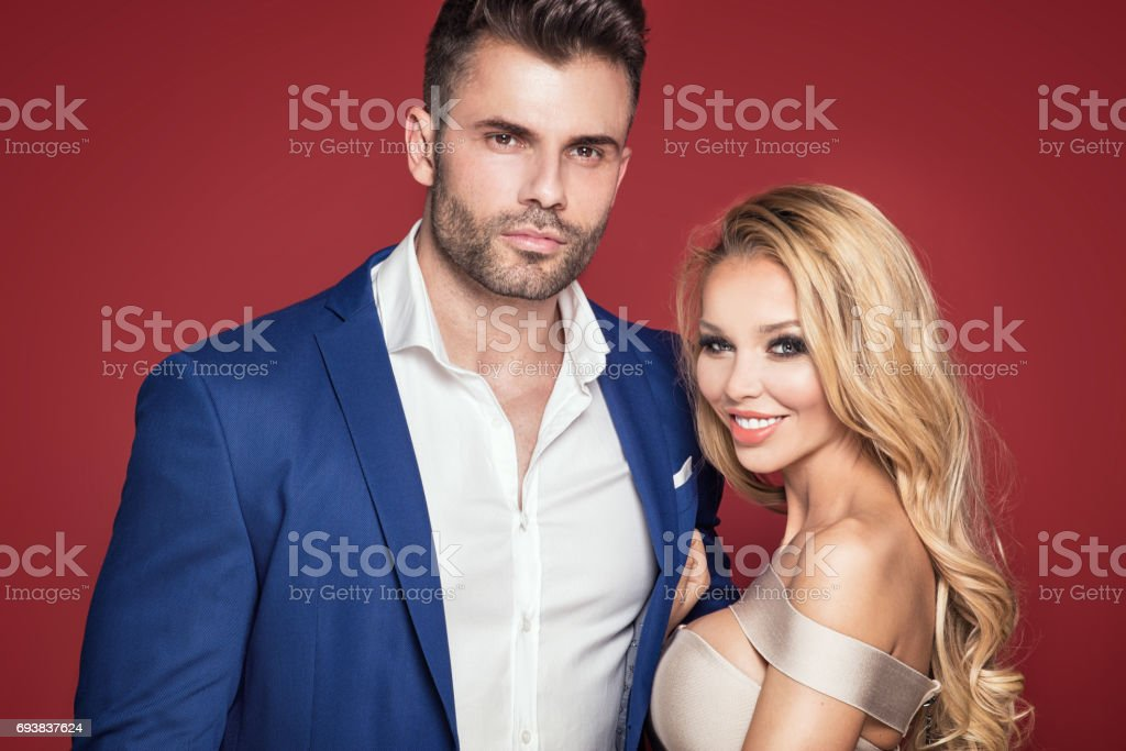 Beautiful elegant couple posing together. stock photo