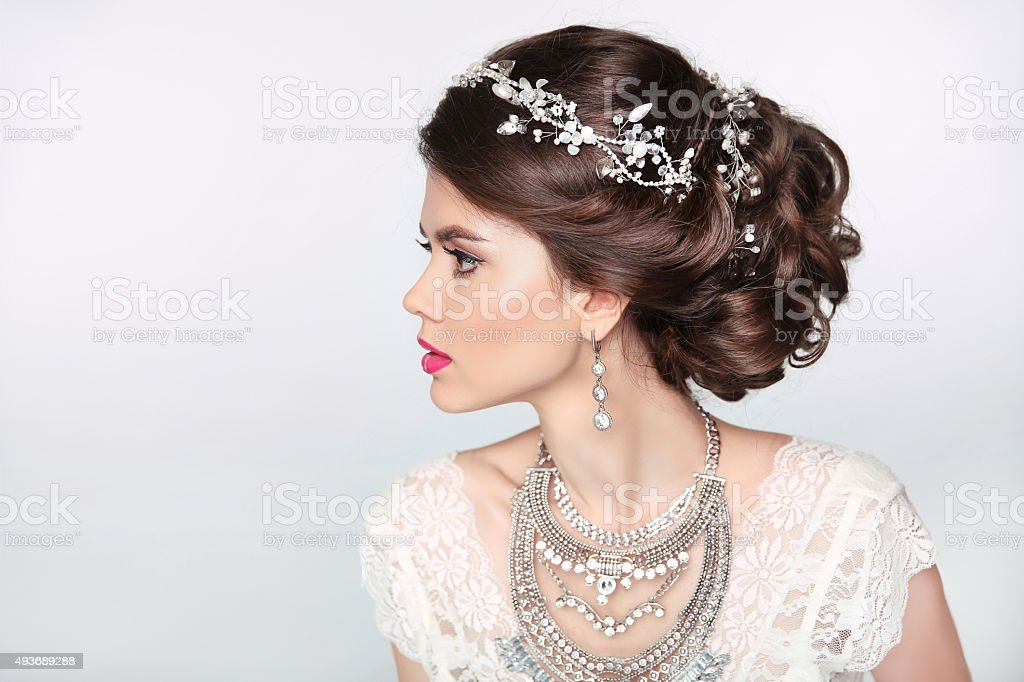 Beautiful elegant girl model with jewelry, makeup and retro hair stock photo