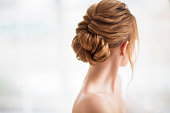 Beautiful elegant wedding hairstyle. Bride. Blond girl with curly hair styling