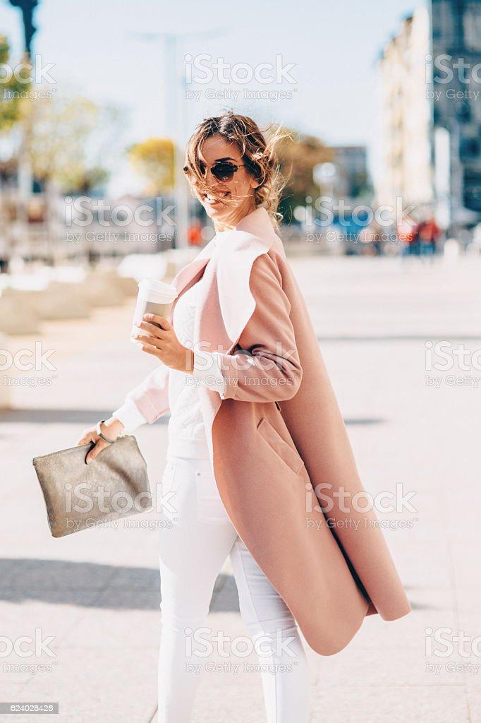Beautiful elegant woman drinking coffee stock photo