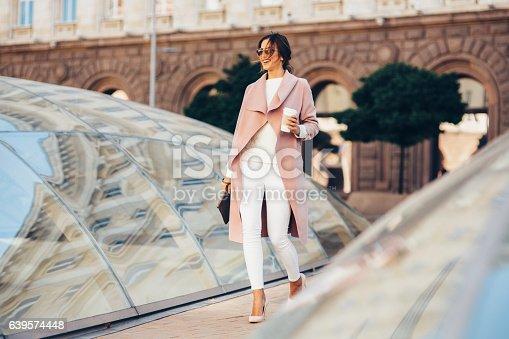 istock Beautiful elegant woman drinking coffee 639574448