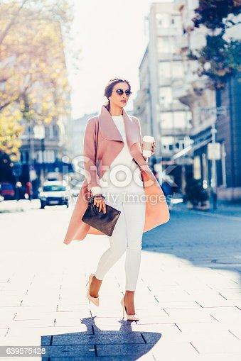istock Beautiful elegant woman drinking coffee 639575428