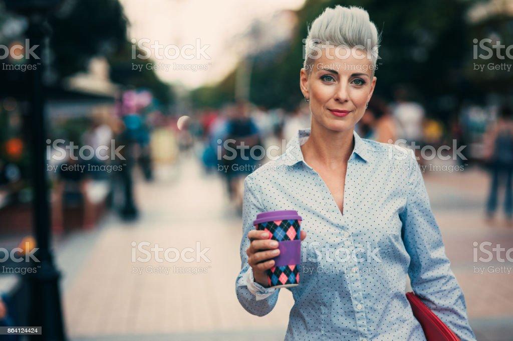 Beautiful elegant woman drinking coffee royalty-free stock photo