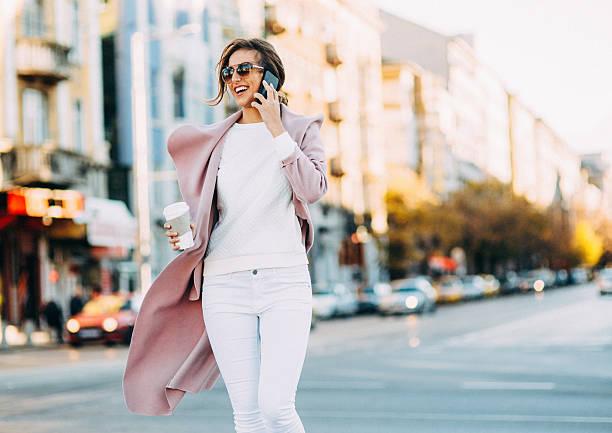 beautiful elegant woman talking on the phone - 春のファッション ストックフォトと画像