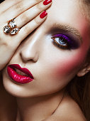 Studio beauty portrait of sensual woman with bright make-up and statement ring. Professional make-up. High-end retouch.