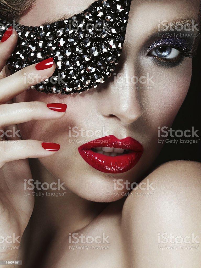 Beautiful elegant woman with eye mask royalty-free stock photo