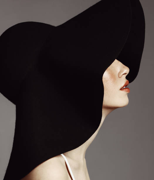 beautiful elegant woman with hat - vintage fashion stock photos and pictures