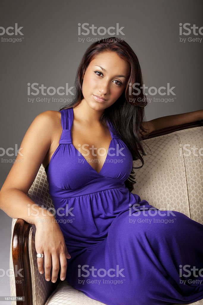 Beautiful Elegant Young Hispanic Woman in Purple Dress royalty-free stock photo