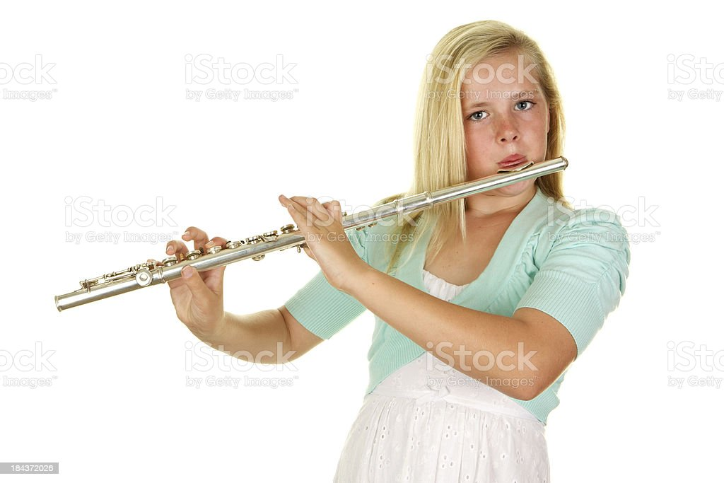 Beautiful Eleven Year Old Girl Playing Flute On White Background