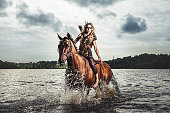 Beautiful elf warrior princess with her horse