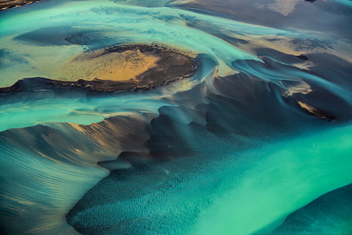 Helicopter view of wonderful turquoise-colored glacial rivers in Iceland.