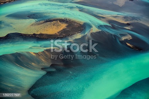 istock Beautiful emerald-colored glacial rivers of Iceland, taken from a helicopter 1202227531