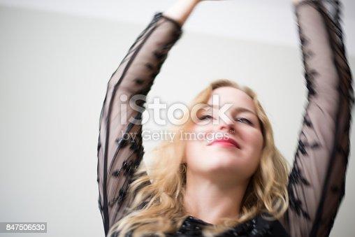 638678178 istock photo Beautiful emotional woman dancing 847506530