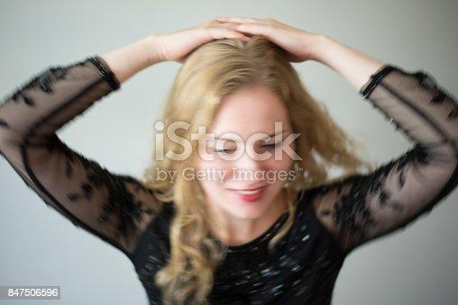 638678178 istock photo Beautiful emotional woman dancing 847506596