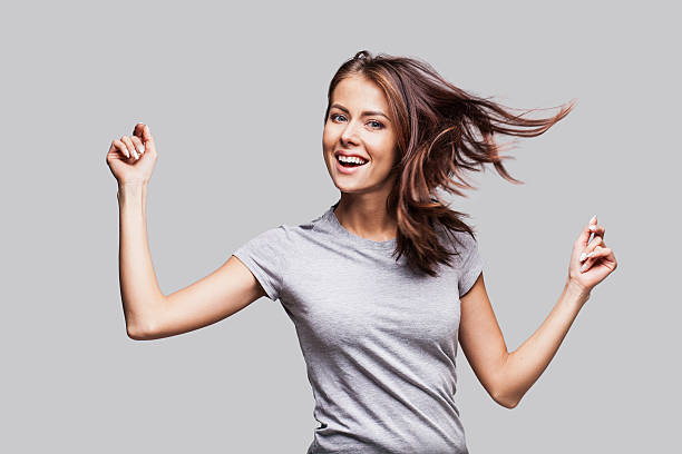 beautiful emotional woman having fun - arms outstretched stock photos and pictures