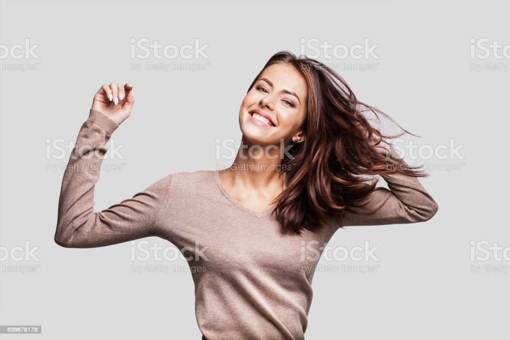 Beautiful emotional woman having fun stock photo