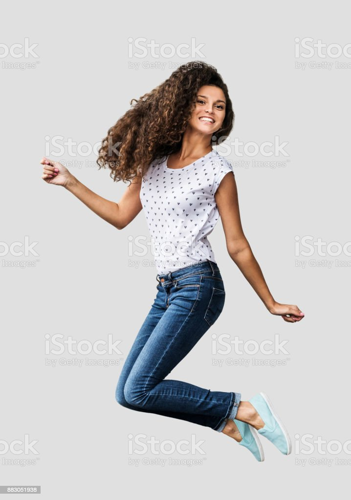 Beautiful emotional woman is jumping and having fun stock photo