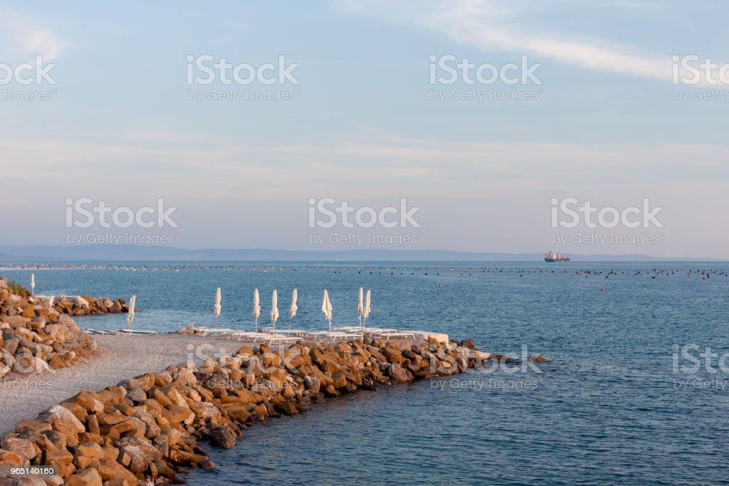 beautiful empty evening seaside beach zbiór zdjęć royalty-free