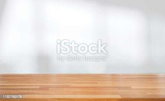 662984808 istock photo Beautiful empty wood table against abstract blur white interior background 1132790178