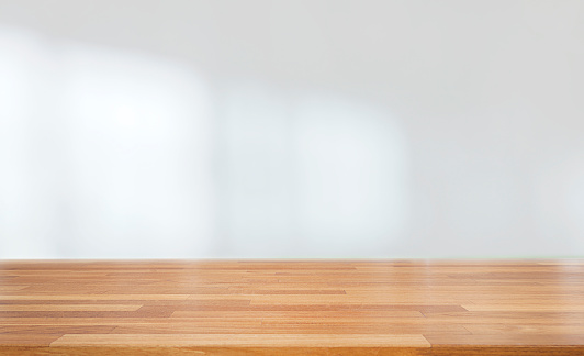 istock Beautiful empty wood table against abstract blur white interior background 1132790179