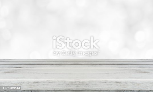 662984808 istock photo Beautiful empty wood table against abstract blur white interior background stock photo 1178788514