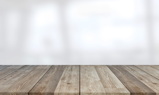 Beautiful empty wood table against abstract blur white interior background stock photo