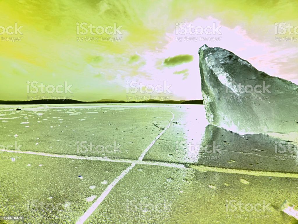 Beautiful epic ice crystal in the frozen bay.  Sun rays reflection in cracks stock photo