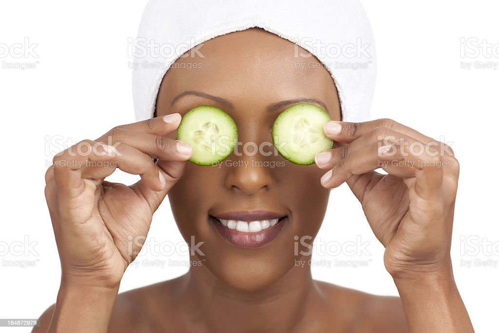 Beautiful ethiopian woman with facial mask of cucumber. royalty-free stock photo