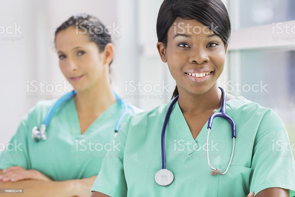 Beautiful ethnic female nurses stock photo