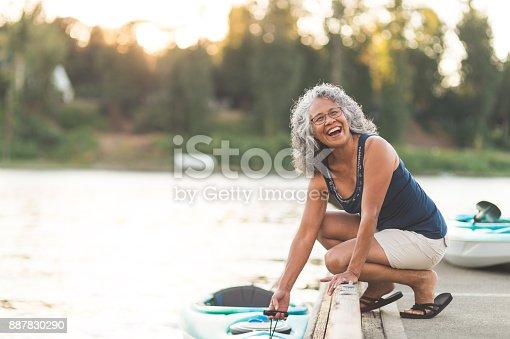 690538774 istock photo A beautiful ethnic older woman prepares to go kayaking 887830290