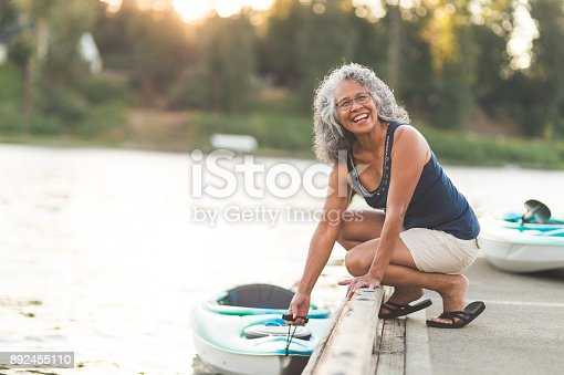istock A beautiful ethnic older woman prepares to go kayaking 892455110