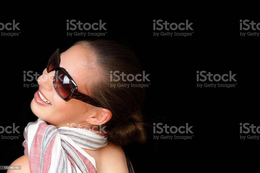 Beautiful ethnic woman with scarf and sunglasses stock photo