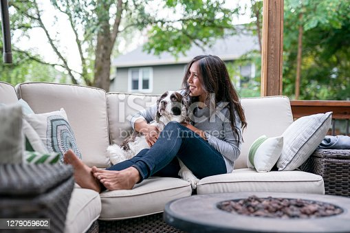 istock Beautiful Eurasian Woman Spending Time With Her Dog Outside 1279059602