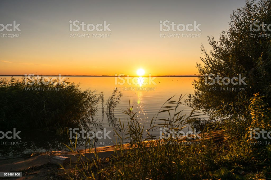 Beautiful Evening landscape with lake, silhouette tree and bushes during sunset.Bhopal India stock photo