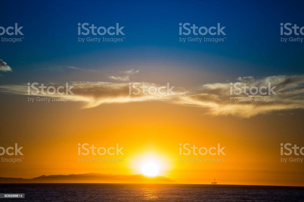 Beautiful evening sunset over ocean stock photo