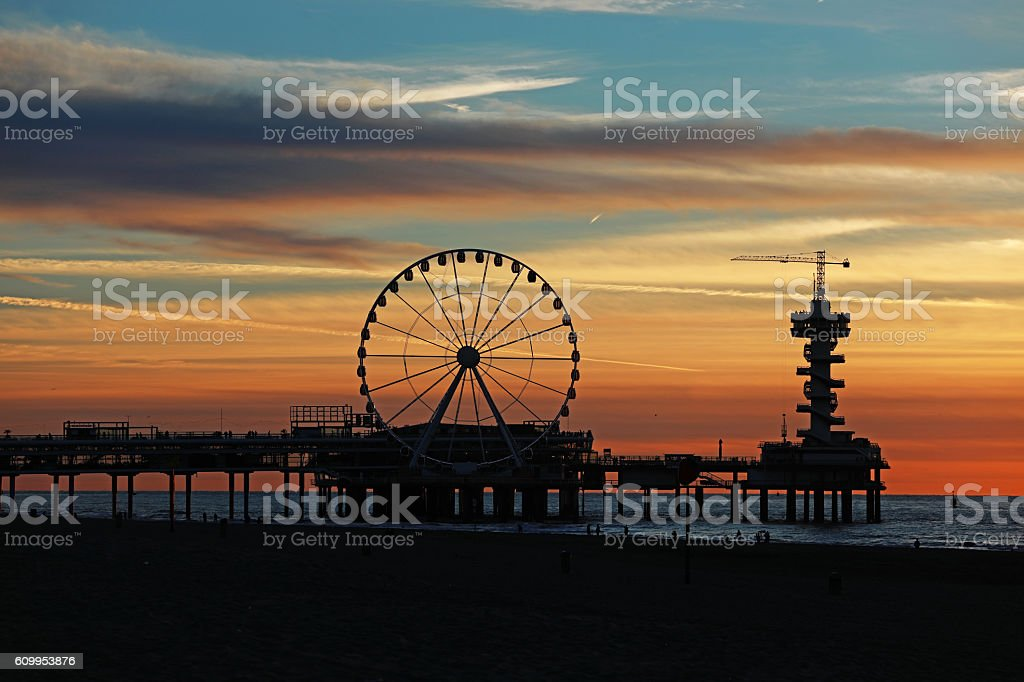 Beautiful evening sunset view of seaside pier and ferris wheel stock photo