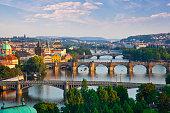 Beautiful evening view of Prague's center part with bridges above Vltava river, sunset, Czech Republic