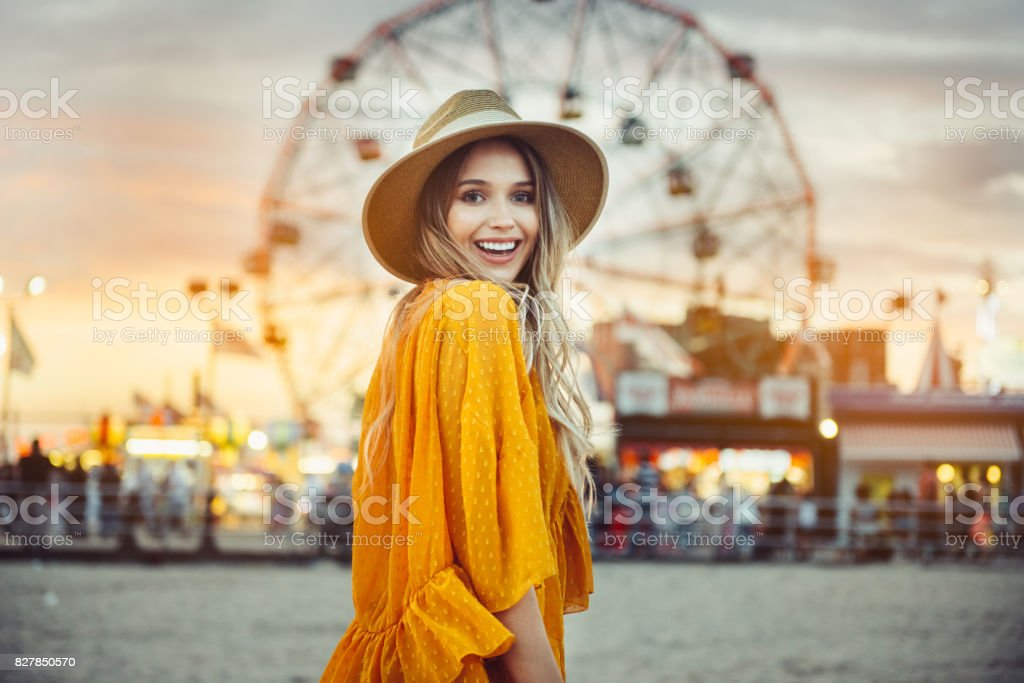 Beautiful exited smiling tourist woman having fun at amusement park royalty-free stock photo