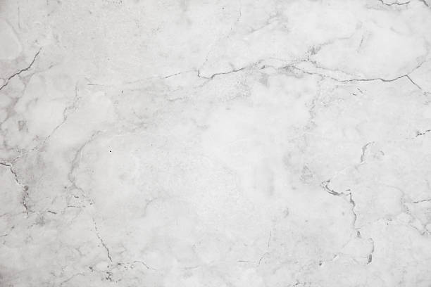 Beautiful exlusive empty white marble background with copy space Background image of a beautiful exclusive white marble top with copy space. marble rock stock pictures, royalty-free photos & images