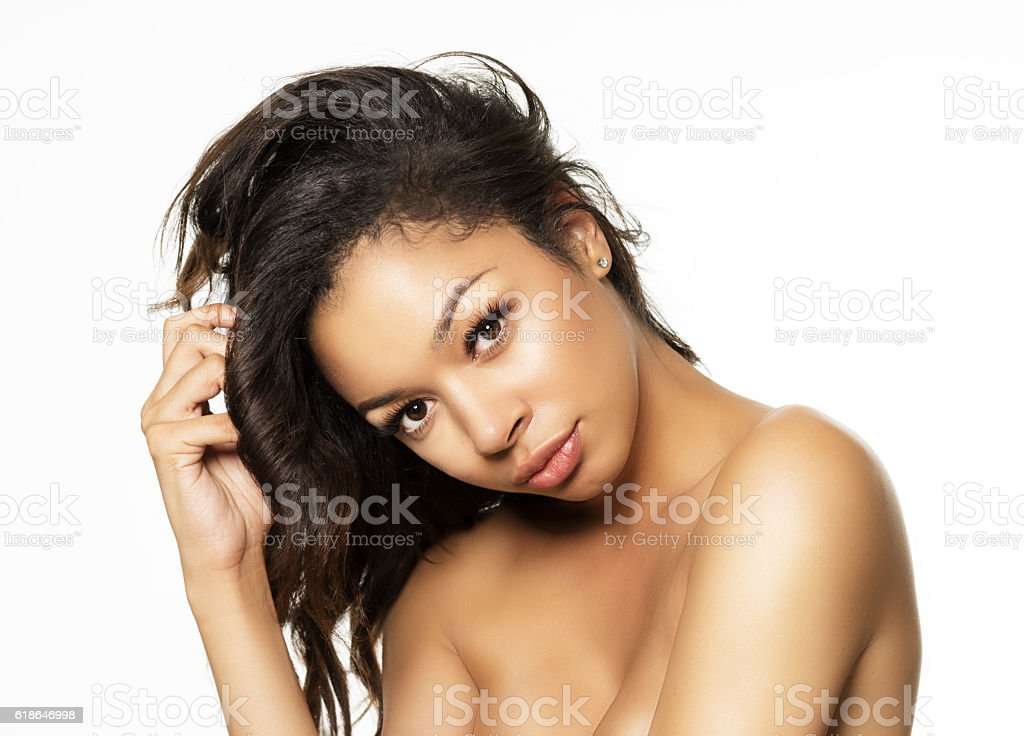 Beautiful exotic young woman with silky golden skin tones stock photo