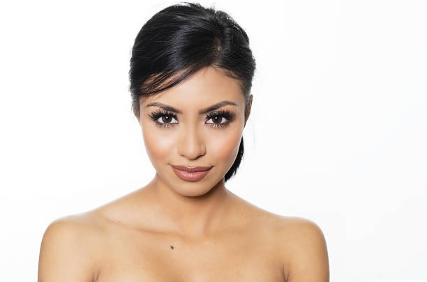 Beautiful exotic young woman's face stock photo