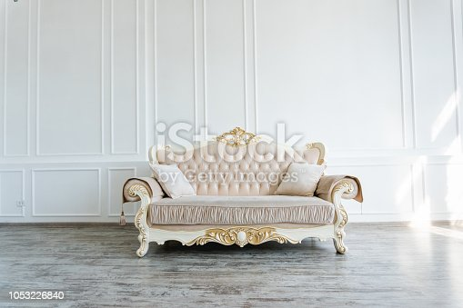 beautiful expensive beige sofa against a white wall in an empty room 1