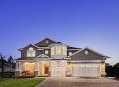 istock Beautiful Exterior of New Luxury Home at Twilight 524085051
