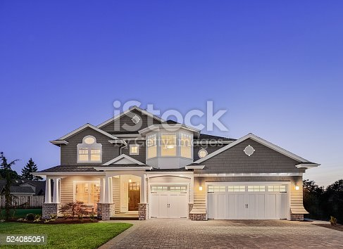 istock Beautiful Exterior of New Luxury Home at Twilight 524085051