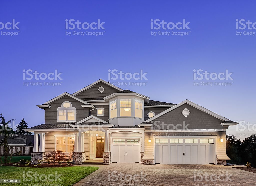 Beautiful Exterior of New Luxury Home at Twilight stok fotoğrafı