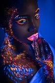 istock beautiful extraterrestrial african model woman in neon light 1226192137
