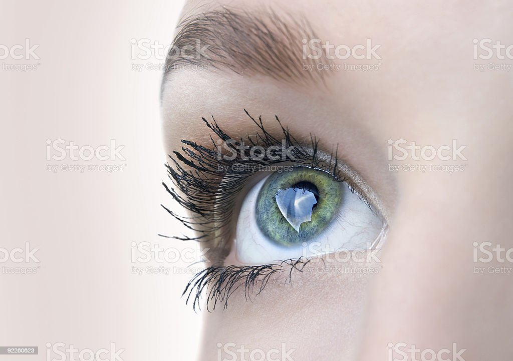 Beautiful eye closeup with images stock photo